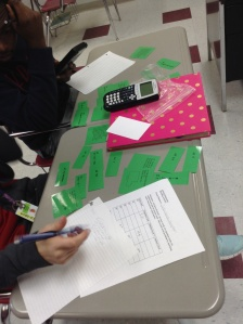 Students work cooperatively on a matching quadratics activity I designed.